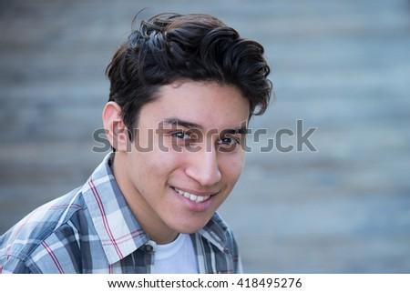 Young Hispanic man smiling  - stock photo