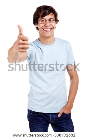 Young hispanic man wearing glasses, blue t-shirt and jeans showing thumb up hand gesture and smiling isolated on white background - success concept - stock photo