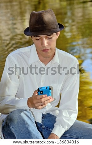 Young Hispanic Man with Cell Phone - stock photo