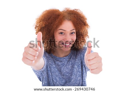 Young hispanic teenage girl making thumbs up gesture isolated on white background