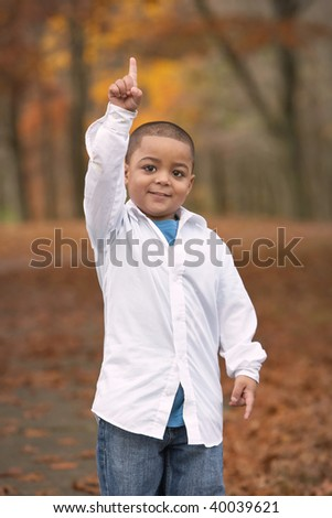 Young hispanic toddler boy showing one with finger - stock photo