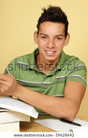 Young hispanic university student studying at home