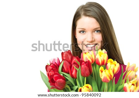 Young Holland woman portrait against white background with tulips bouquet and smiling at camera - stock photo