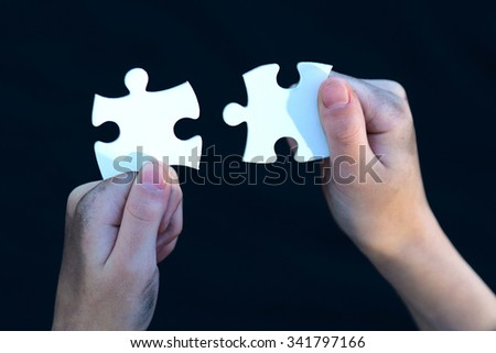 young homeless boy holding puzzles, dirty hand, dream concept,   success and strategy concept,