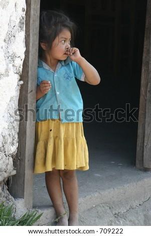 Young Honduran Girl Standing in Doorway - stock photo