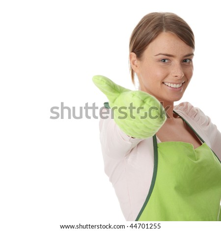 Young house wife in kitchen, isolated on white background - stock photo