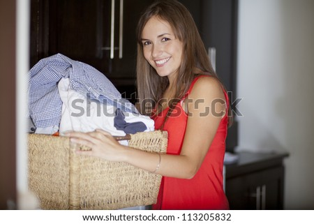 Young housewife doing the laundry - stock photo