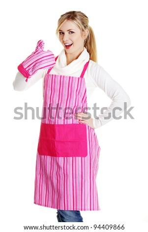 Young housewife in pink apron, isolated on white