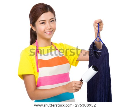 Young housewife using the dirt sticker on clothes