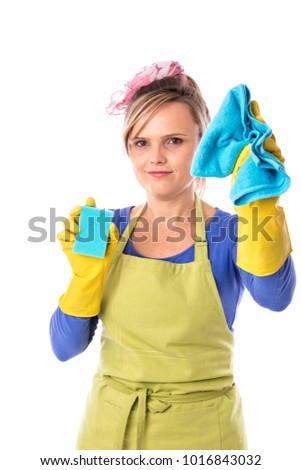 Young housewife with apron and yellow gloves cleaning on white