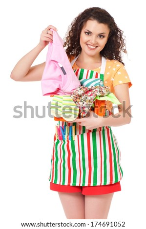 Young housewife with laundry basket, isolated on white background - stock photo