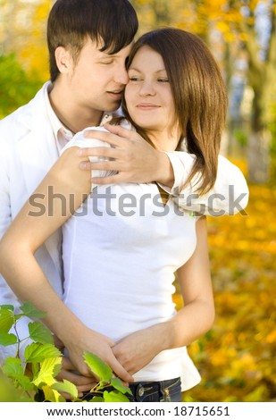 young hugging couple in autumn park - stock photo