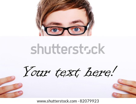 Young in glasses holding blank board for your text - stock photo