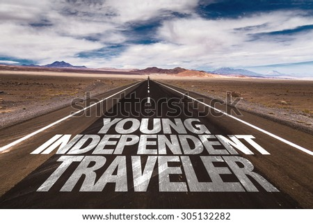 Young Independent Traveler written on desert road - stock photo