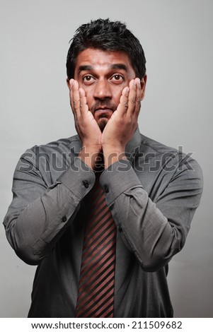 Young Indian business executive  with a shocking expression - stock photo
