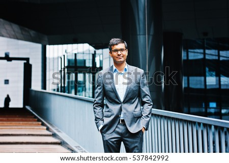 Young indian businessman standing outdoor