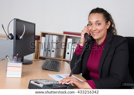 young indian businesswoman working in office - stock photo