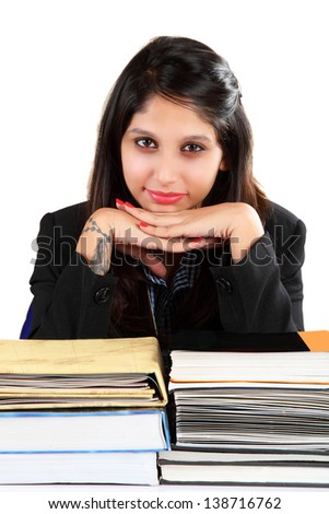 Young Indian girl sitting with  lots of books - stock photo
