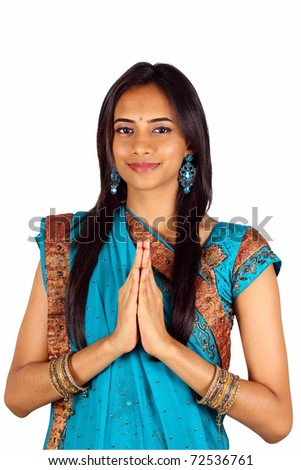 Young Indian in a namaste(greeting) pose. Isolated on a white background. - stock photo