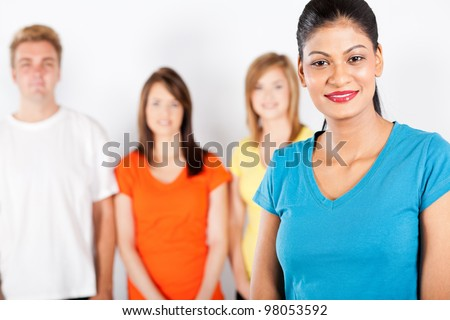 young indian woman in front of group of people - stock photo