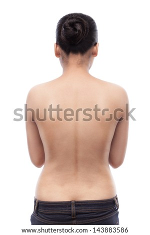 Young indian woman showing her smooth skinned back and wearing blue jeans, isolated on white - stock photo