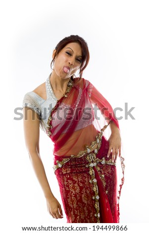 Young Indian woman sticking out her tongue - stock photo