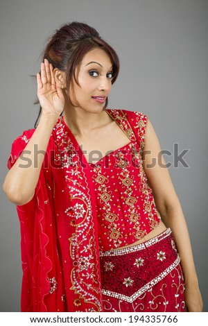 Young Indian woman trying to listen - stock photo
