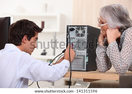 Young installing computer