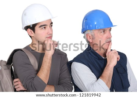 Young intern copying master's body  language - stock photo