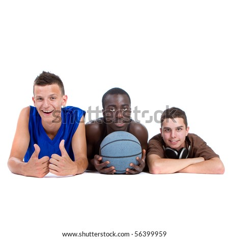 Young interracial group of happy sporty teenagers lying on the floor. Isolate over white. - stock photo