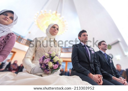 Young islamic couple marrying in mosque - stock photo