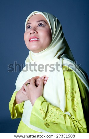 Young Islamic woman in traditional clothing - stock photo