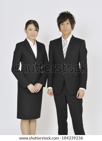 Young Japanese business woman and business man