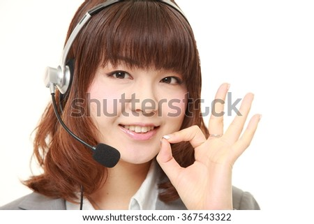 young Japanese Business woman  of call center showing perfect sign - stock photo