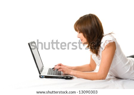 Young japanese businesswoman with laptop lying on the floor. Isolated
