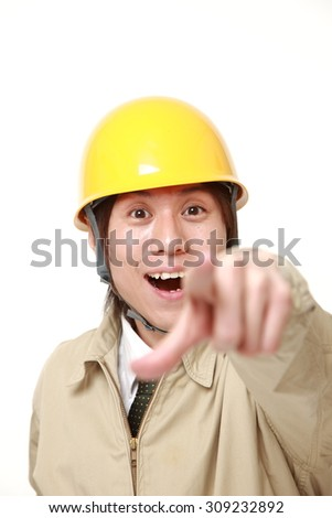 young Japanese construction worker discover something