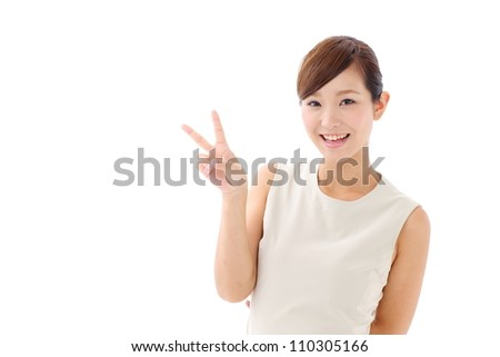 young japanese girl showing victory sign isolated on white background