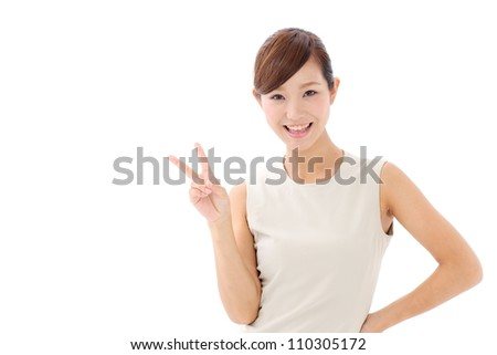 young japanese girl showing victory sign isolated on white background - stock photo