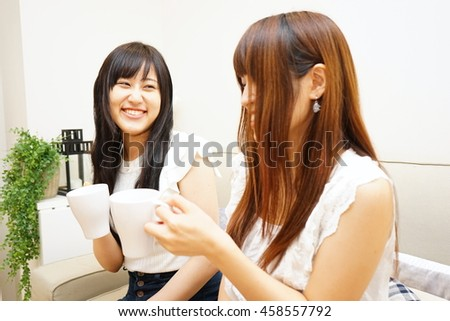 Young Japanese girls having a home party at home