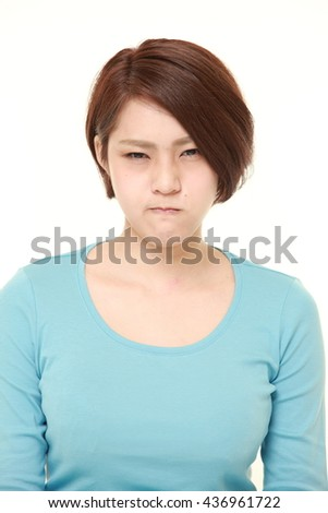 young Japanese woman in a bad mood