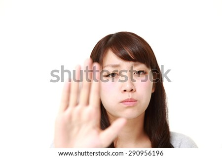 young Japanese woman making stop gesture - stock photo