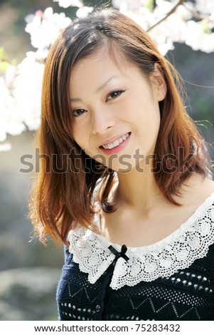 Young japanese woman, outdoor portrait
