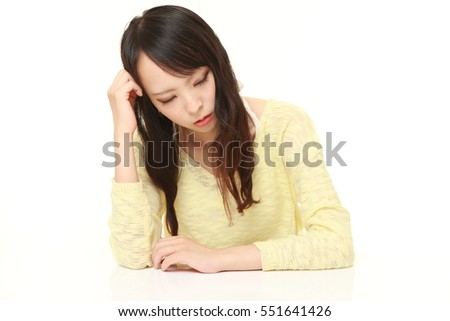 Young Japanese Woman Sleeping on the Table on white background