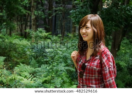 Young Japanese woman walking in a mountain or forest