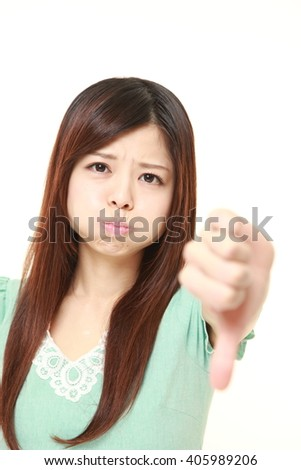 young Japanese woman with thumbs down gesture