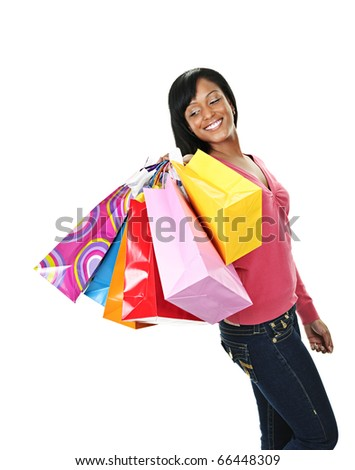 Young joyful black woman holding shopping bags