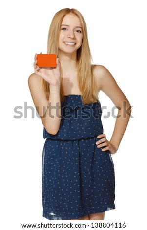 Young joyful woman holding blank credit card, over white background - stock photo