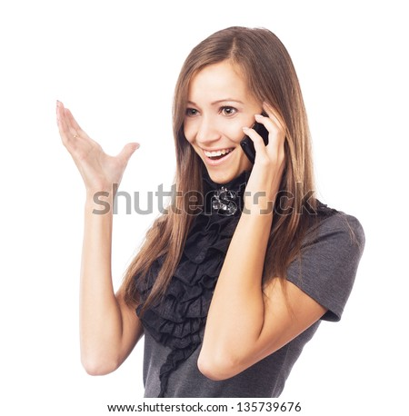Young joyful woman talking on mobile phone against white background - stock photo