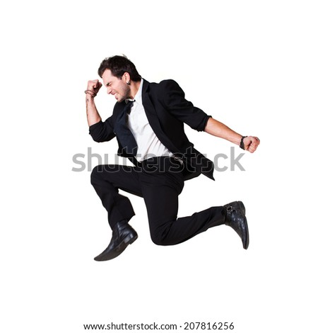 young jumping businessman with success gesture - stock photo