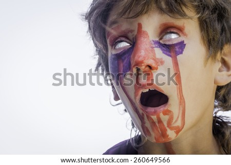 young kid - boy - with painted faces, child zombie face art - stock photo